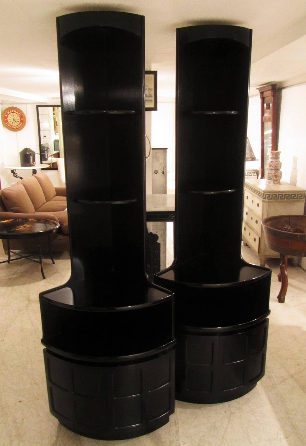 A pair of corner cabinets