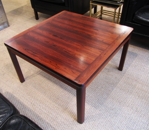 A rosewood coffee table