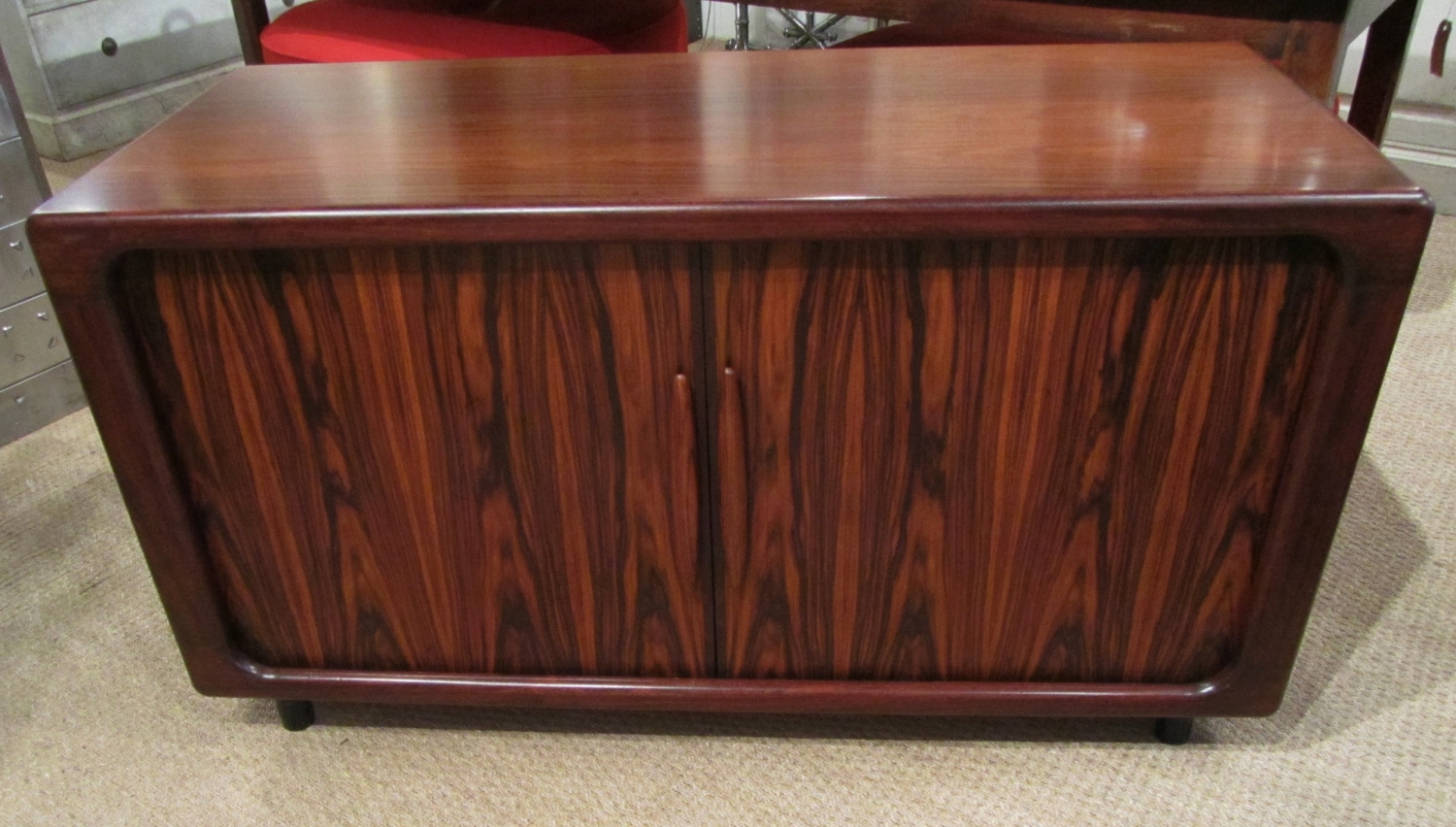 A rosewood tambour cabinet
