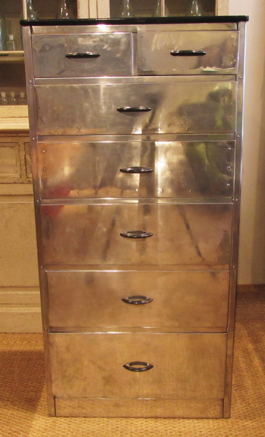 An Aluminium tall chest of drawers