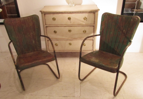 A pair of iron cafe chairs