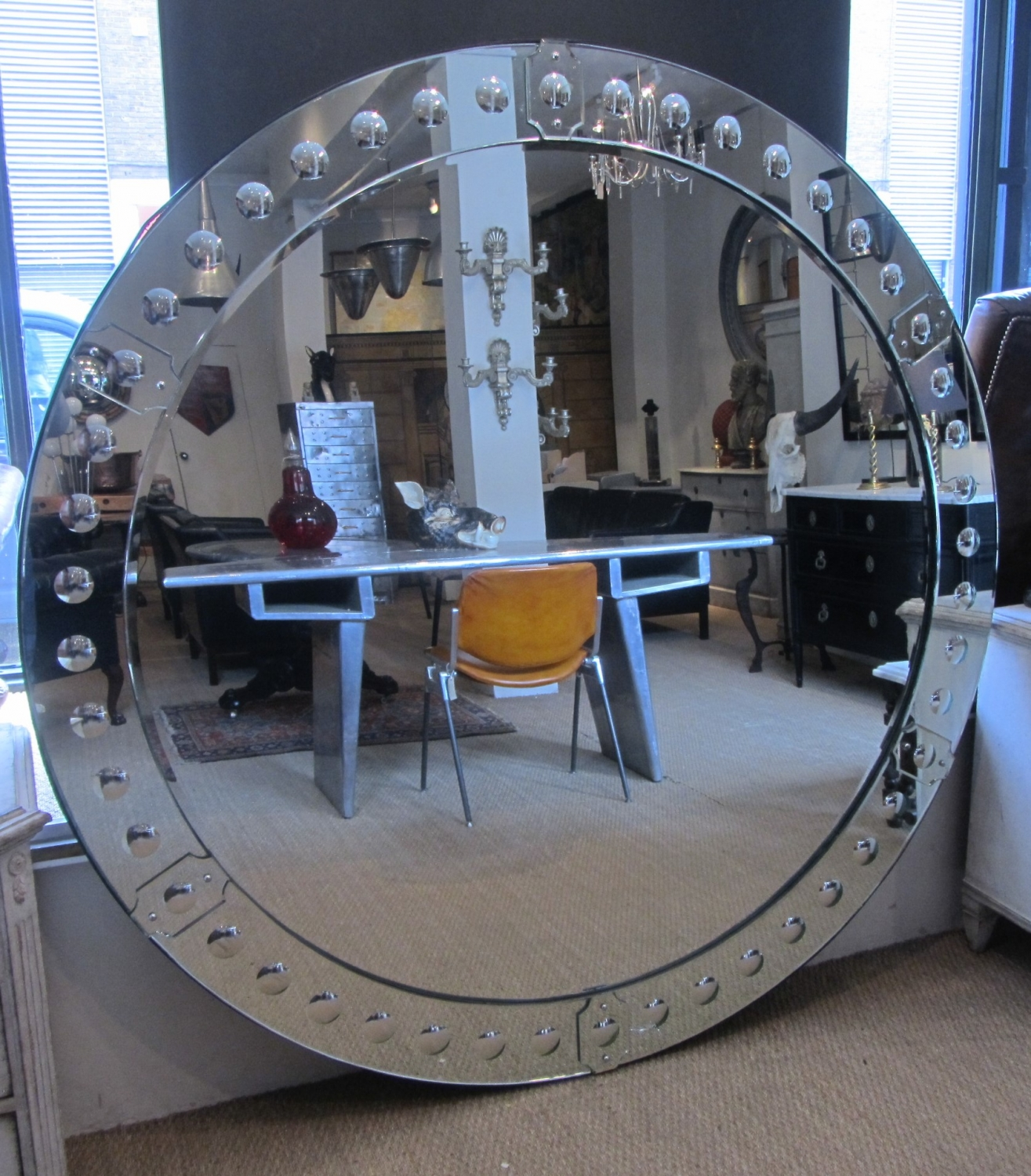A large round punted mirror