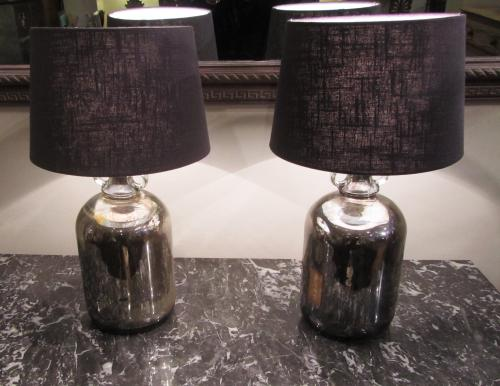 A pair of silvered lamps