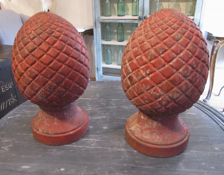 A pair of iron finials