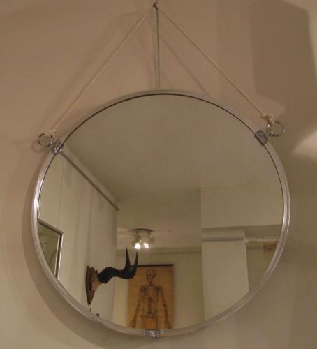 A round deco mirror