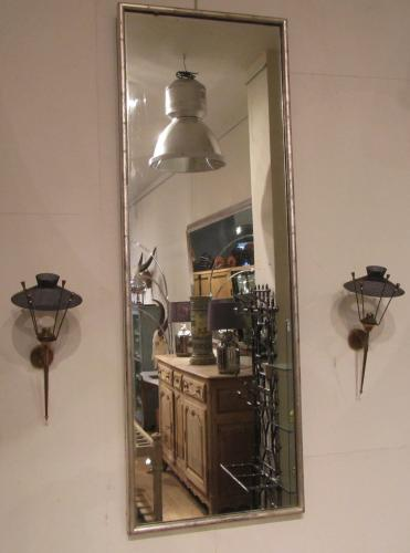 A silver gilt shop mirror