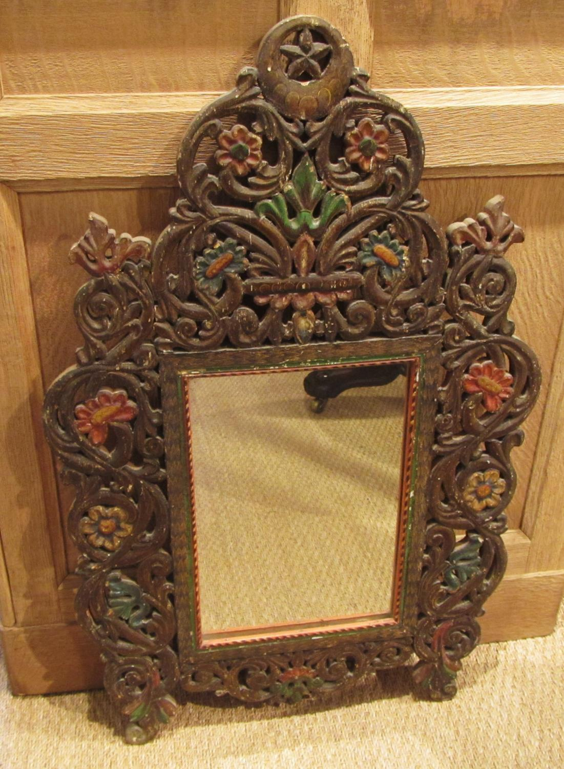 A small 19thC painted wood mirror