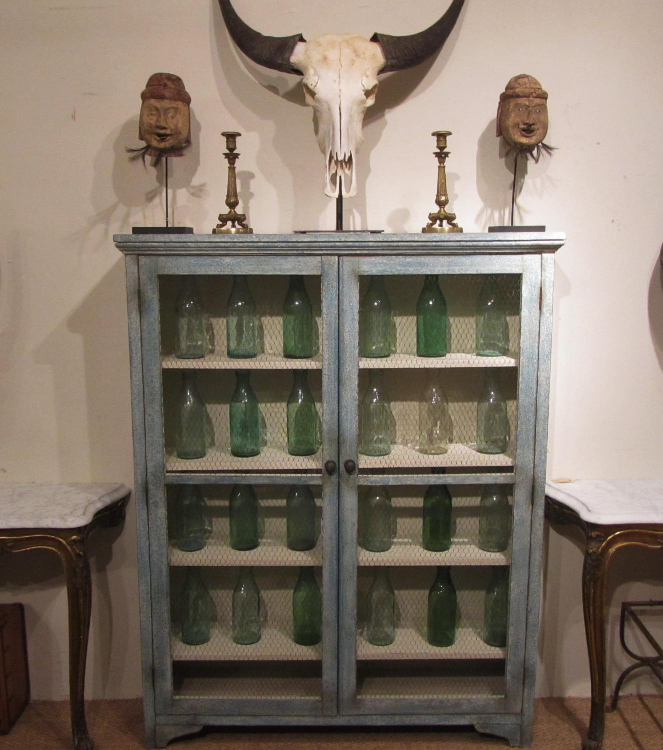 A painted larder cabinet