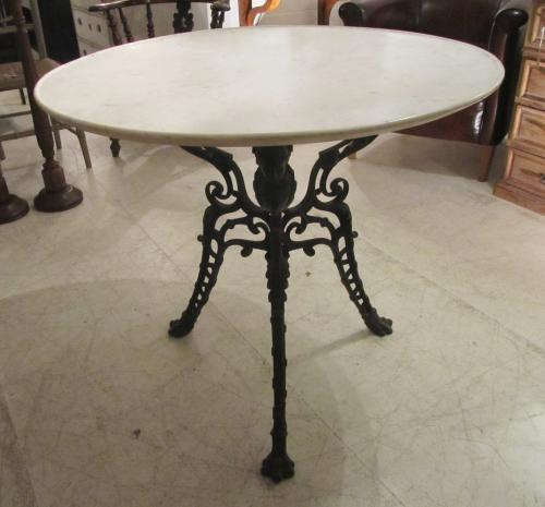 A cast iron and marble table