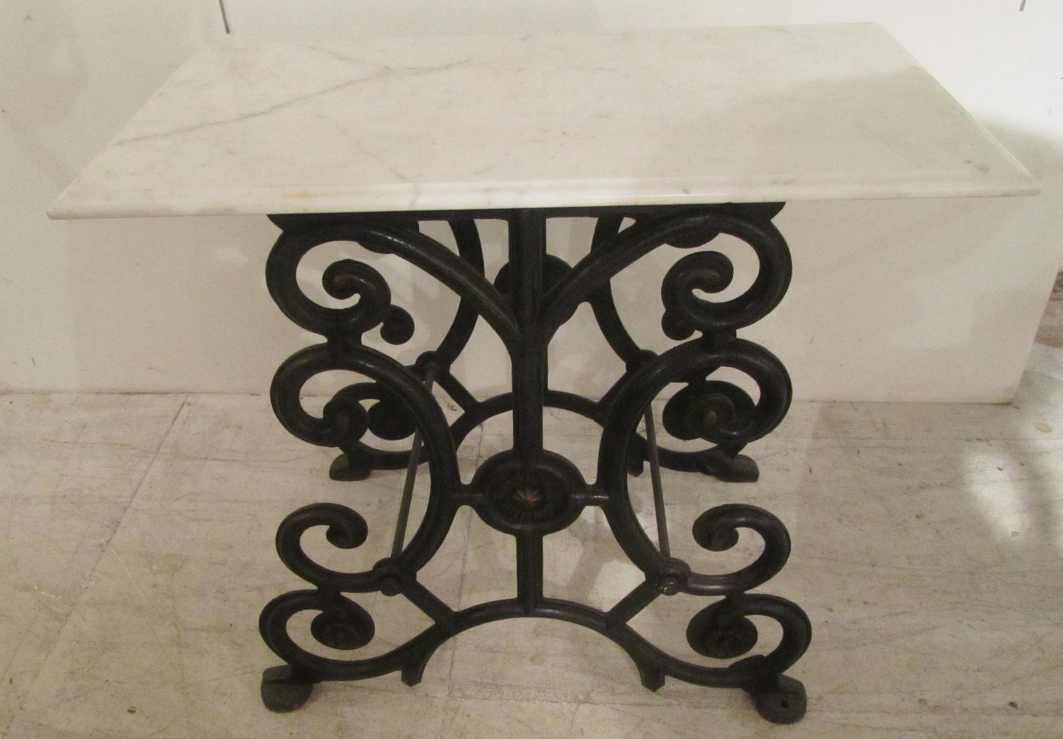 A 19thC iron and marble table