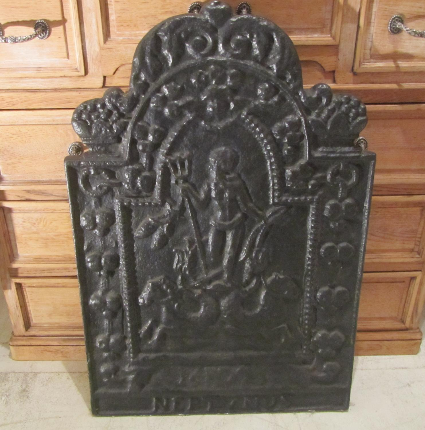 A cast iron fire back