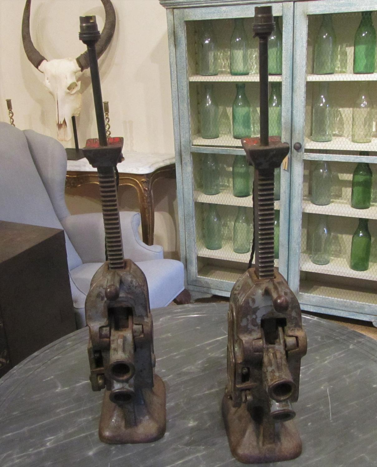 A pair of bottle jack lamps