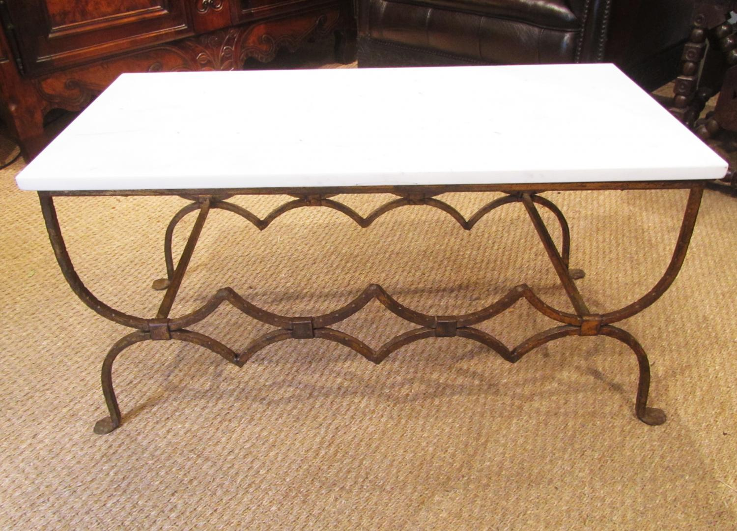 A gilt iron coffee table