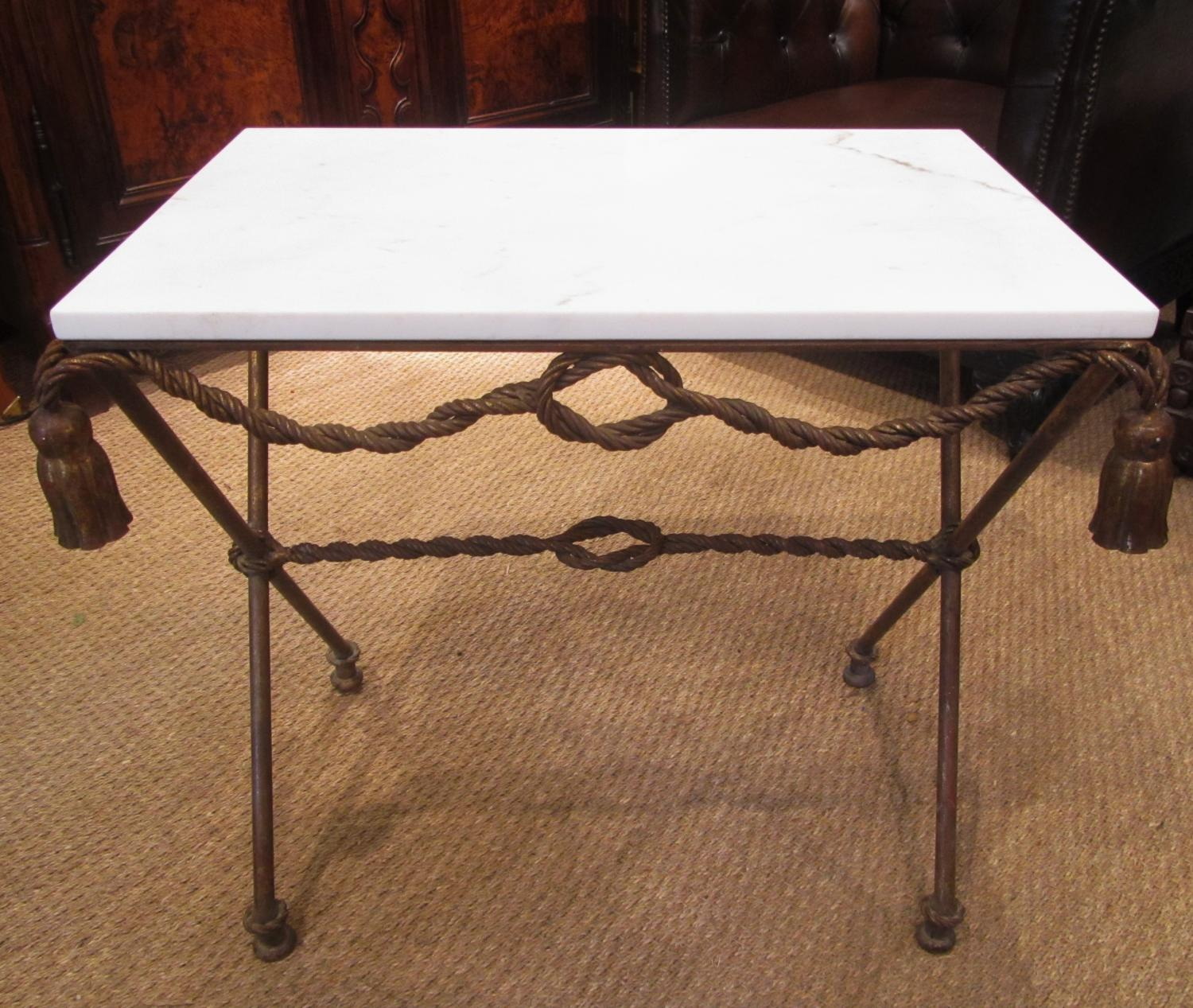 A gilt metal and marble side table