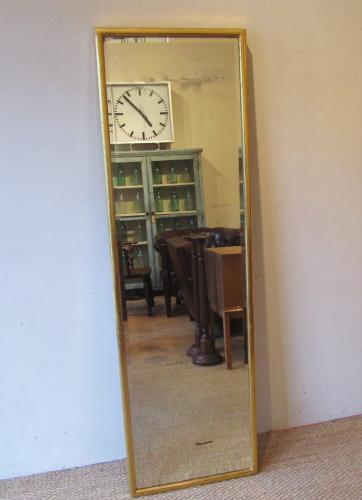 A gilded milliners shop mirror