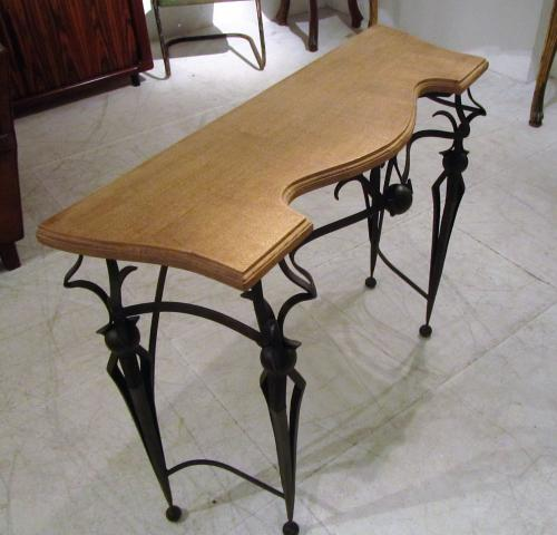 A pair of wrought iron consoles