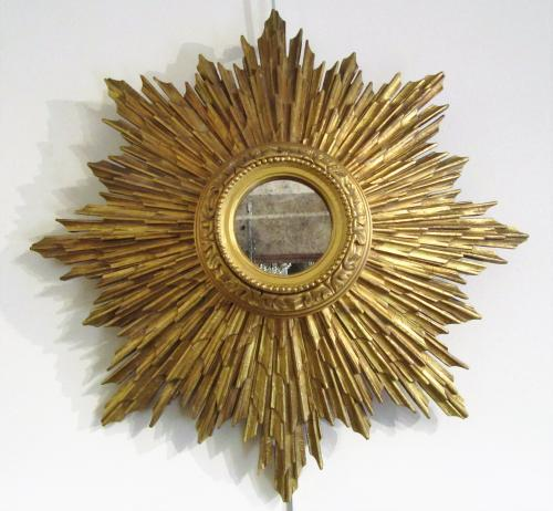 A pair of sunburst gilt mirrors