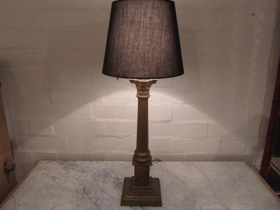A pair of Corinthian column lamps