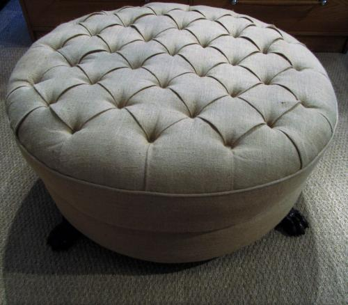 A large round foot stool ottoman