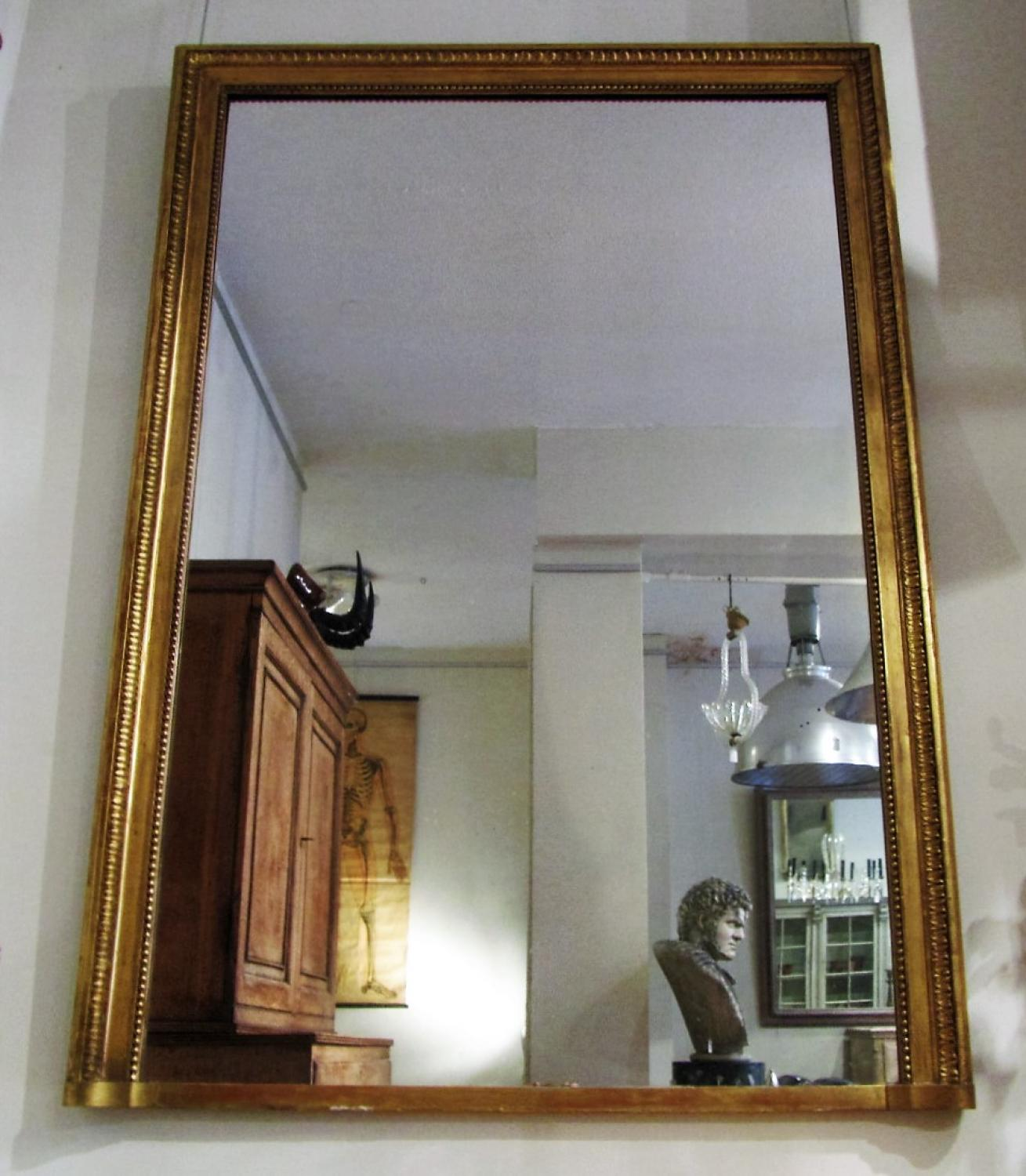 A large giltwood over mantle mirror