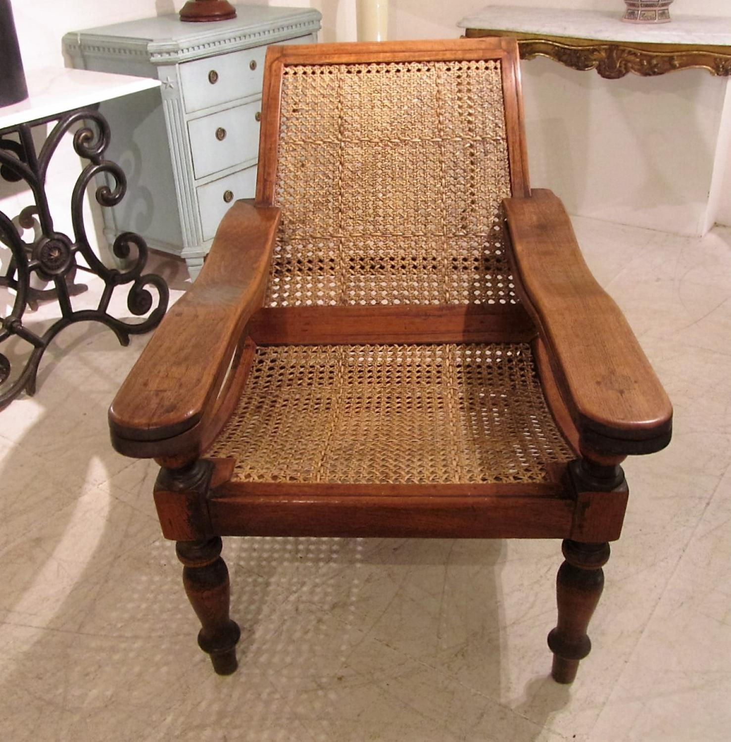 A caned plantation chair