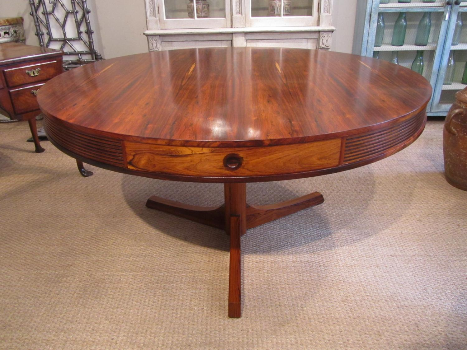 A rosewood drum dining table