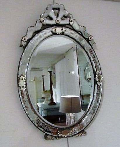 An Oval venetian mirror