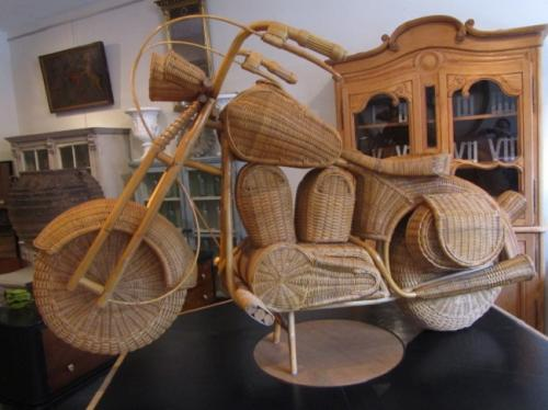 A wicker work sculpture of a vintage Harley D