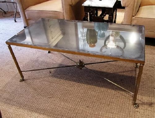 A brass and mirror coffee table