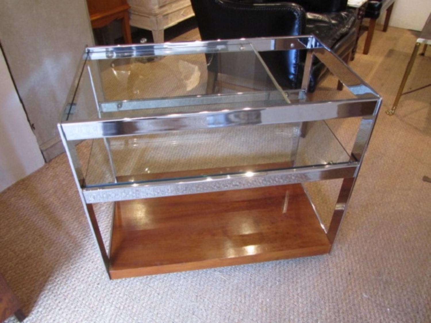 A rosewood and chrome drinks cart trolley