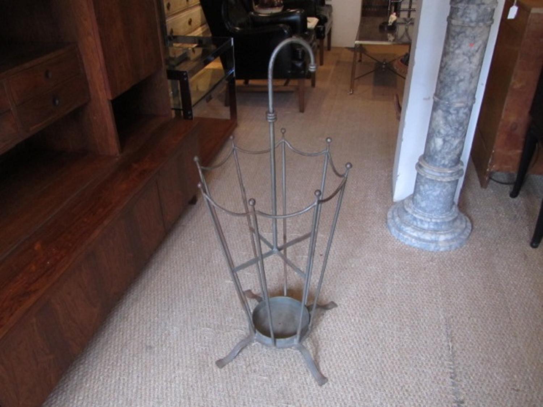 An Umbrella shaped umbrella/stick stand