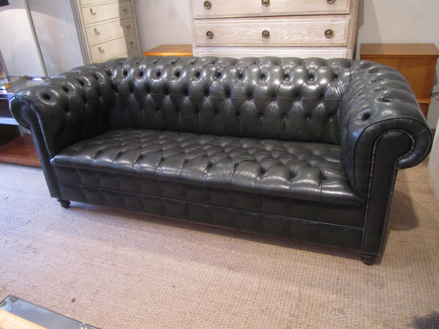 A fully buttoned leather chesterfield sofa