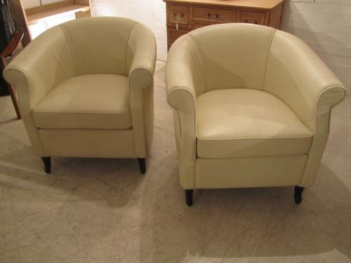A pair of deco leather armchairs