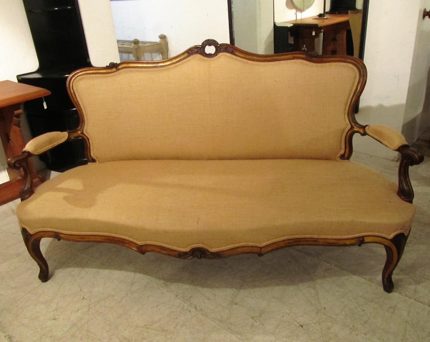 A walnut and parcel gilt settee
