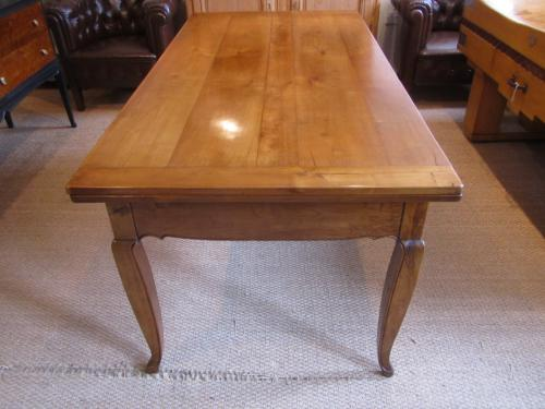 A cherry wood farmhouse table