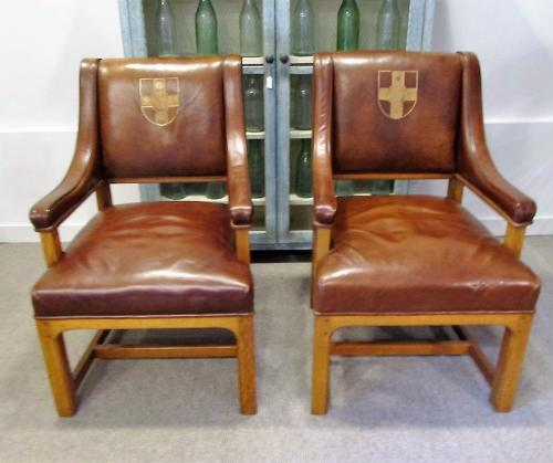 A pair of leather dean's chairs