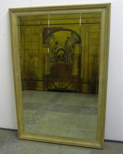 A bleached carved walnut mirror
