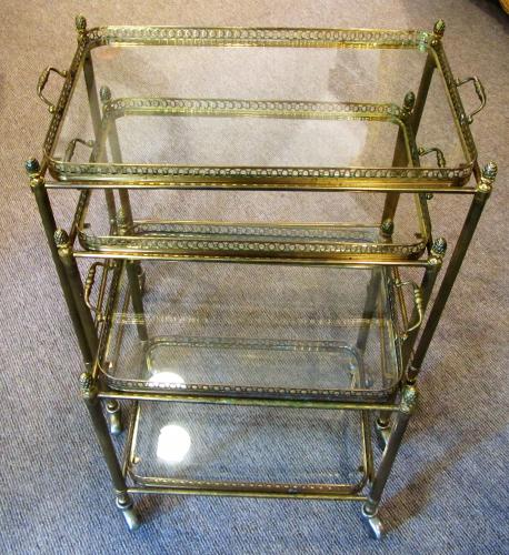 A nest of brass drinks trolleys