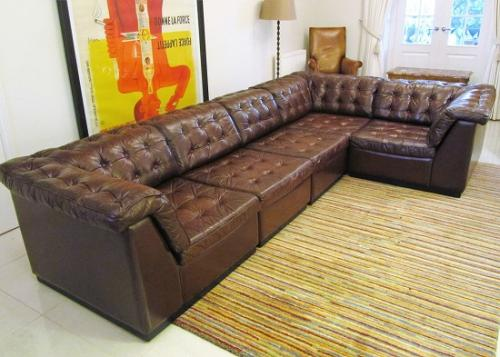 A buttoned leather sectional sofa