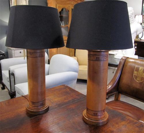 A pair of leather and Mahogany lamps