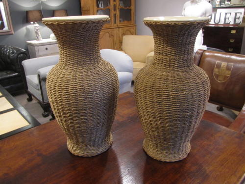 A large pair of rattan wrapped ceramic vases