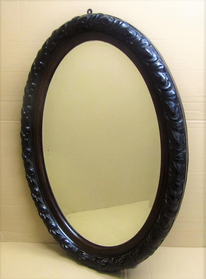 An oval bevelled mirror