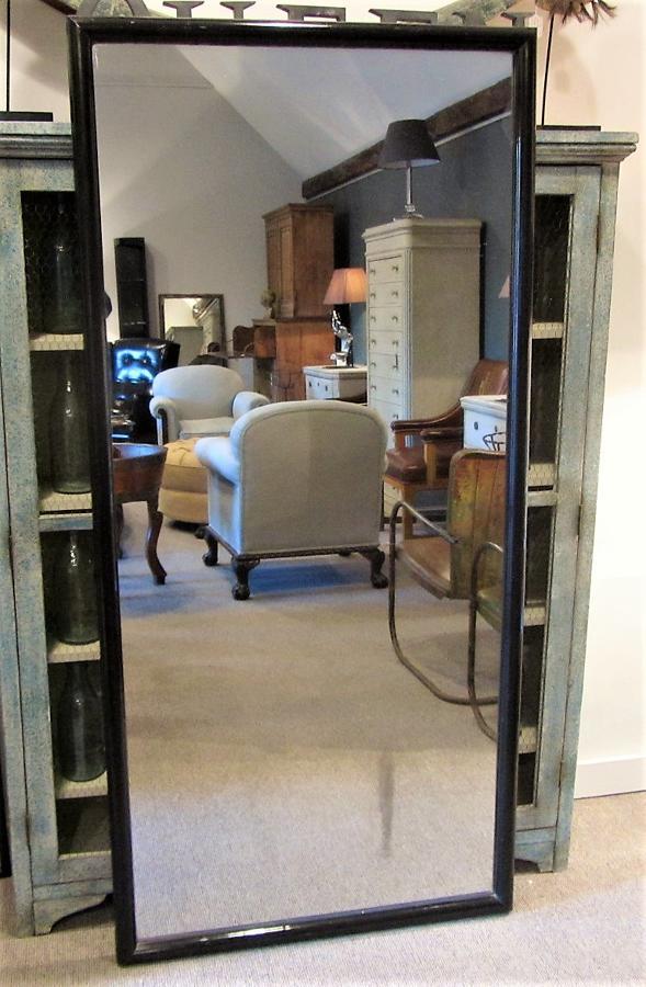 A large mercury shop mirror