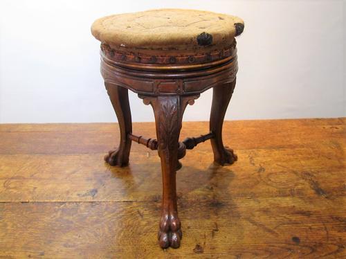 A 19thC Walnut tripod stool by Howe London