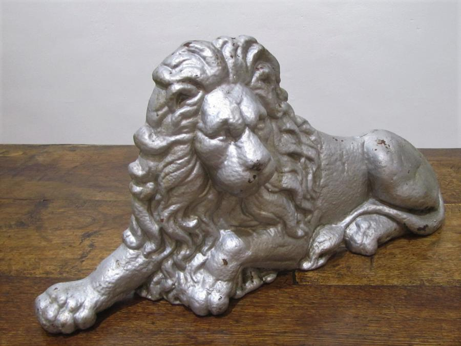 A cast iron Lion boot scrape