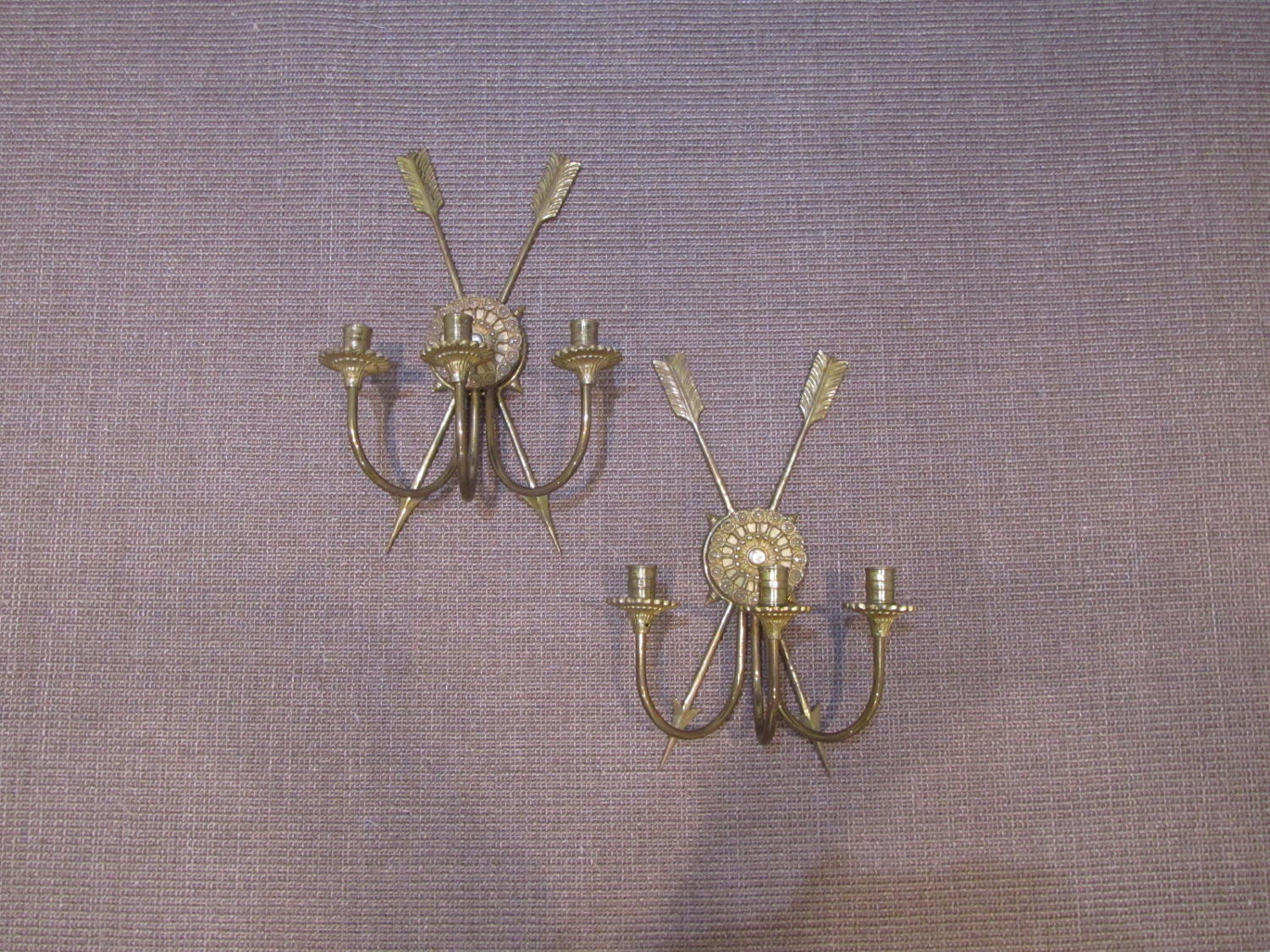 A pair of brass Maison Jansen wall appliques