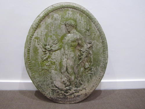 A composite stone oval plaque