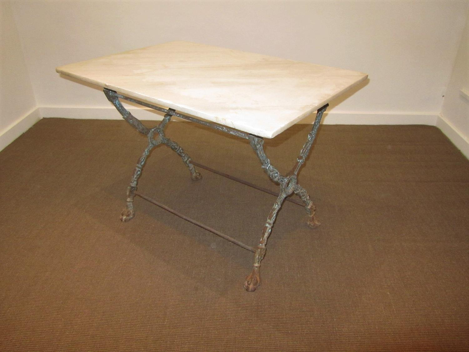 A cast iron x frame table