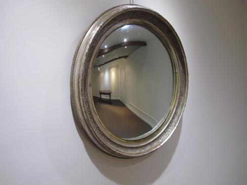A large silver gilt convex mirror