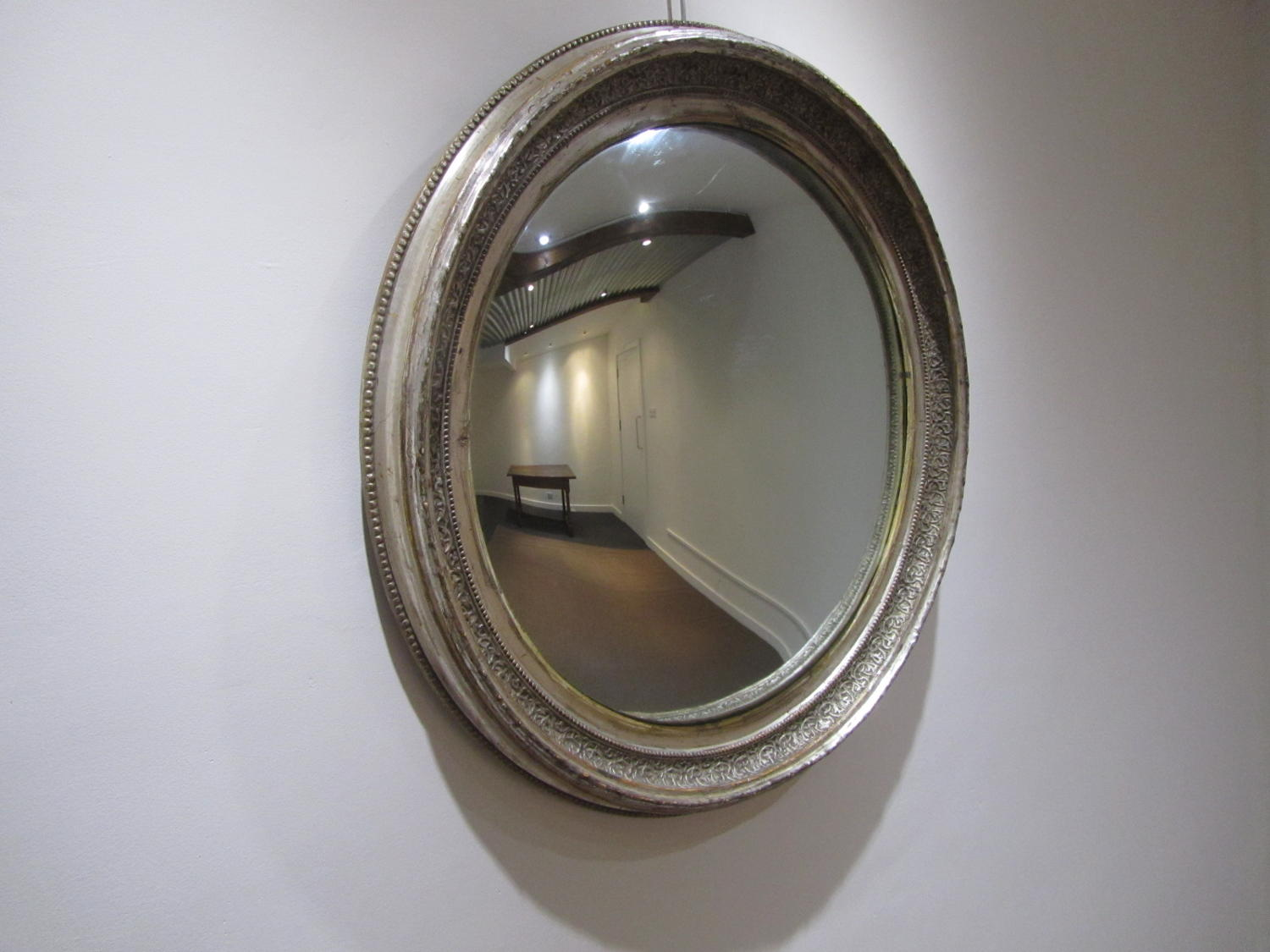 A large silver gilt convex mirror